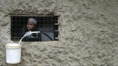 A woman waits for customers in her paraffin shop in the sprawling Kibera slums in Kenya's capital Nairobi