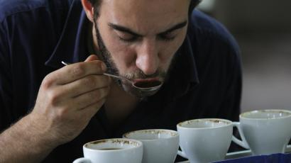 A foreign investor tastes coffee at a local coffee factory in Santiago.