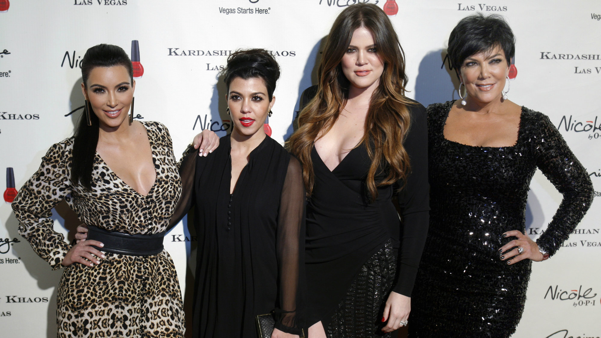 Television personalities (L-R) Kim Kardashian, Kourtney Kardashian, Khloe Kardashian and Kris Jenner arrive at the grand opening of the Kardashian Khaos store at the Mirage Hotel and Casino in Las Vegas, Nevada December 15, 2011.