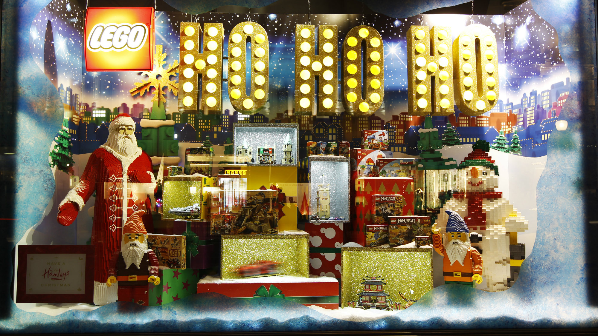 People look at a display of Lego toys in the window of Hamleys toy shop in London, December 2, 2011.