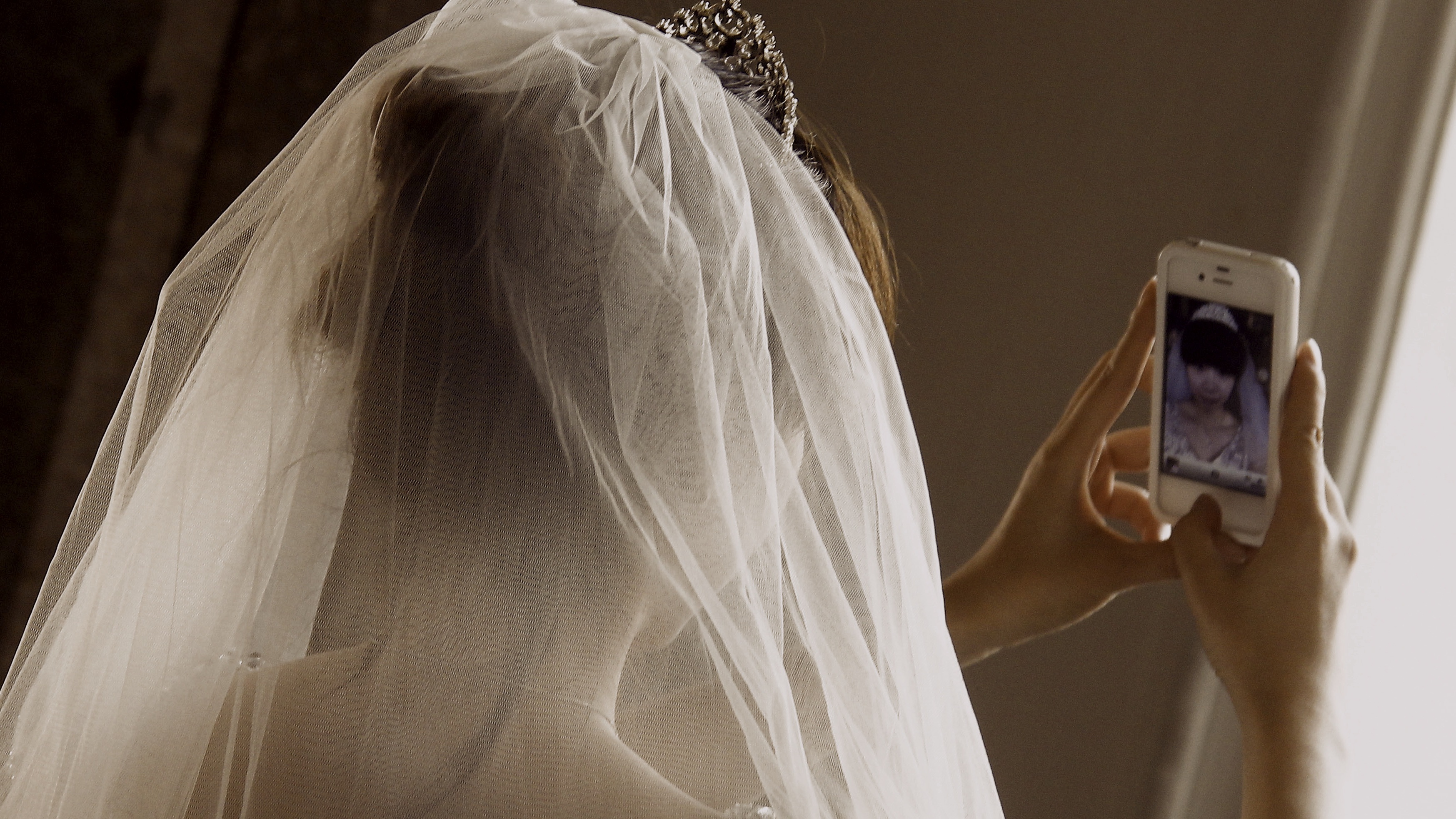 A Chinese bride takes a self portrait before her symbolic wedding in Fuessen