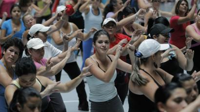 People participate in an aerobics class at the gymnasium of a sports center in Cartago.