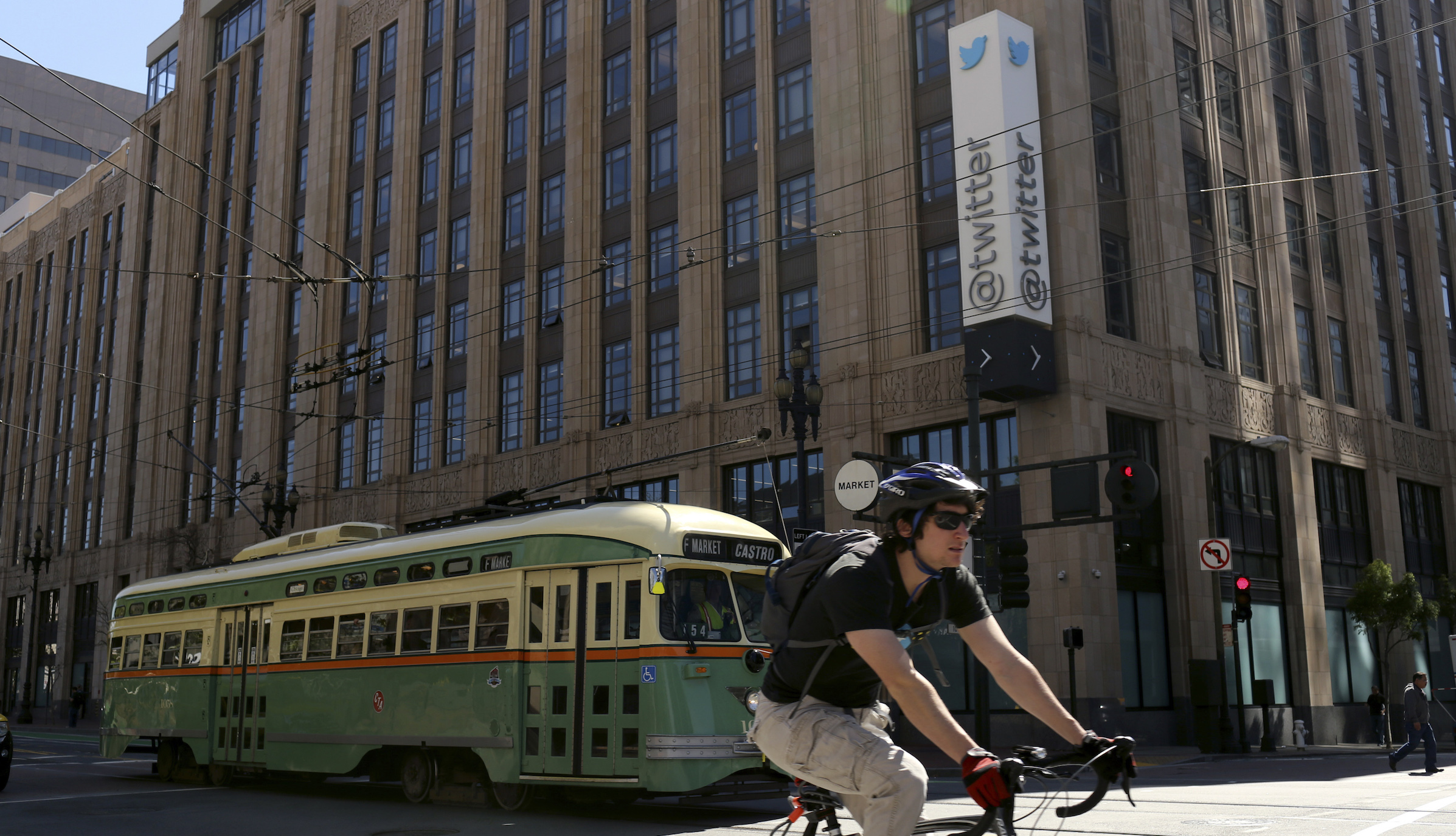 A vintage streetcar passes in front of the Twitter headquarters on Market Street in San Francisco, California April 29, 2014. The company is to report first quarter earnings after market close REUTERS/Robert Galbraith  (UNITED STATES - Tags: BUSINESS TRANSPORT LOGO SOCIETY) - RTR3N5H3