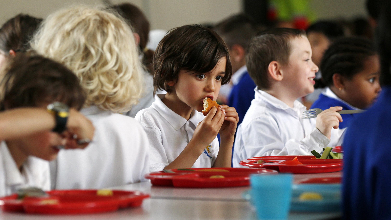 Students eat lunch at Salusbury Primary School in northwest London June 11, 2014.