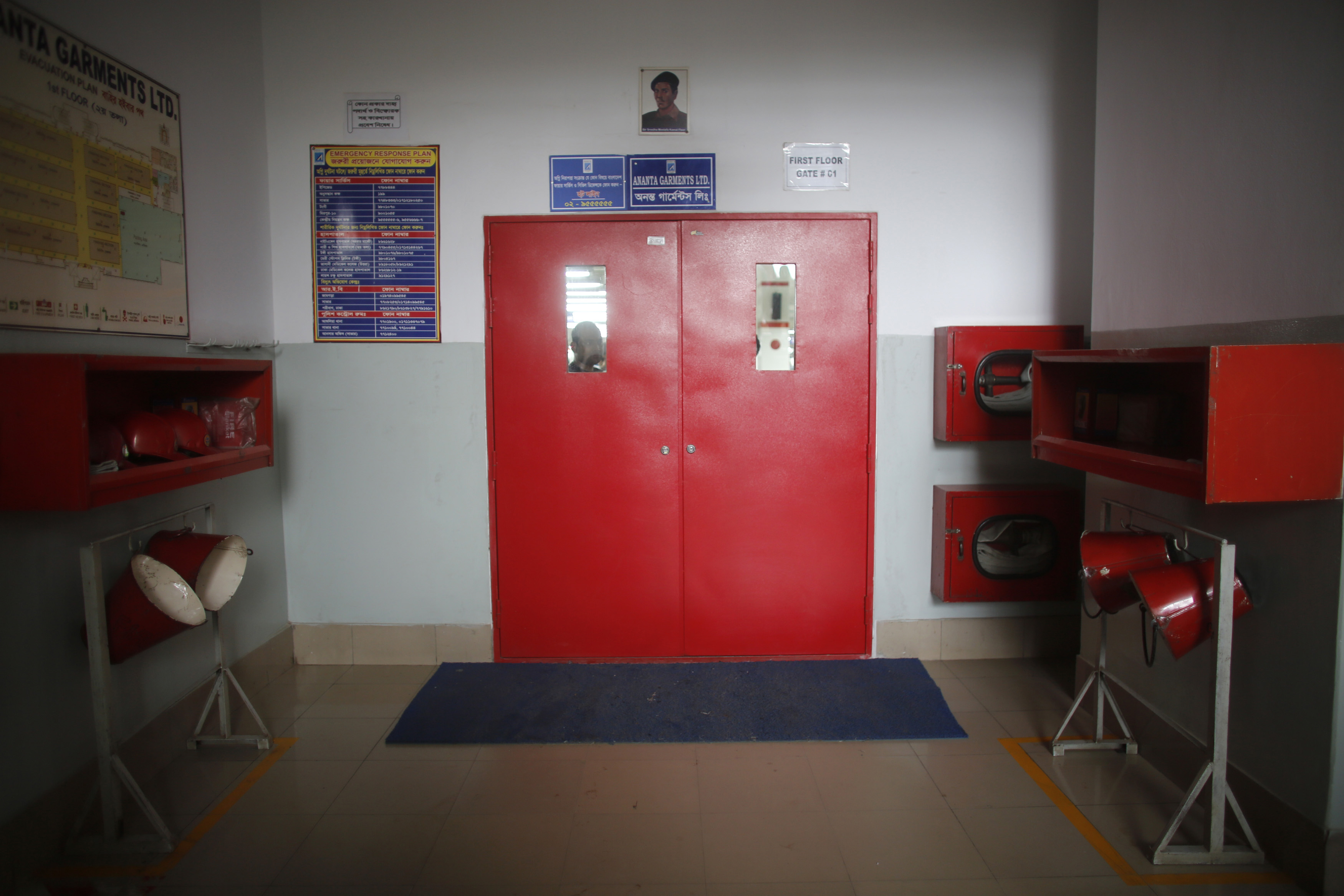 A newly installed fire door is seen in a factory of Ananta Garments Ltd in Savar June 10, 2014.