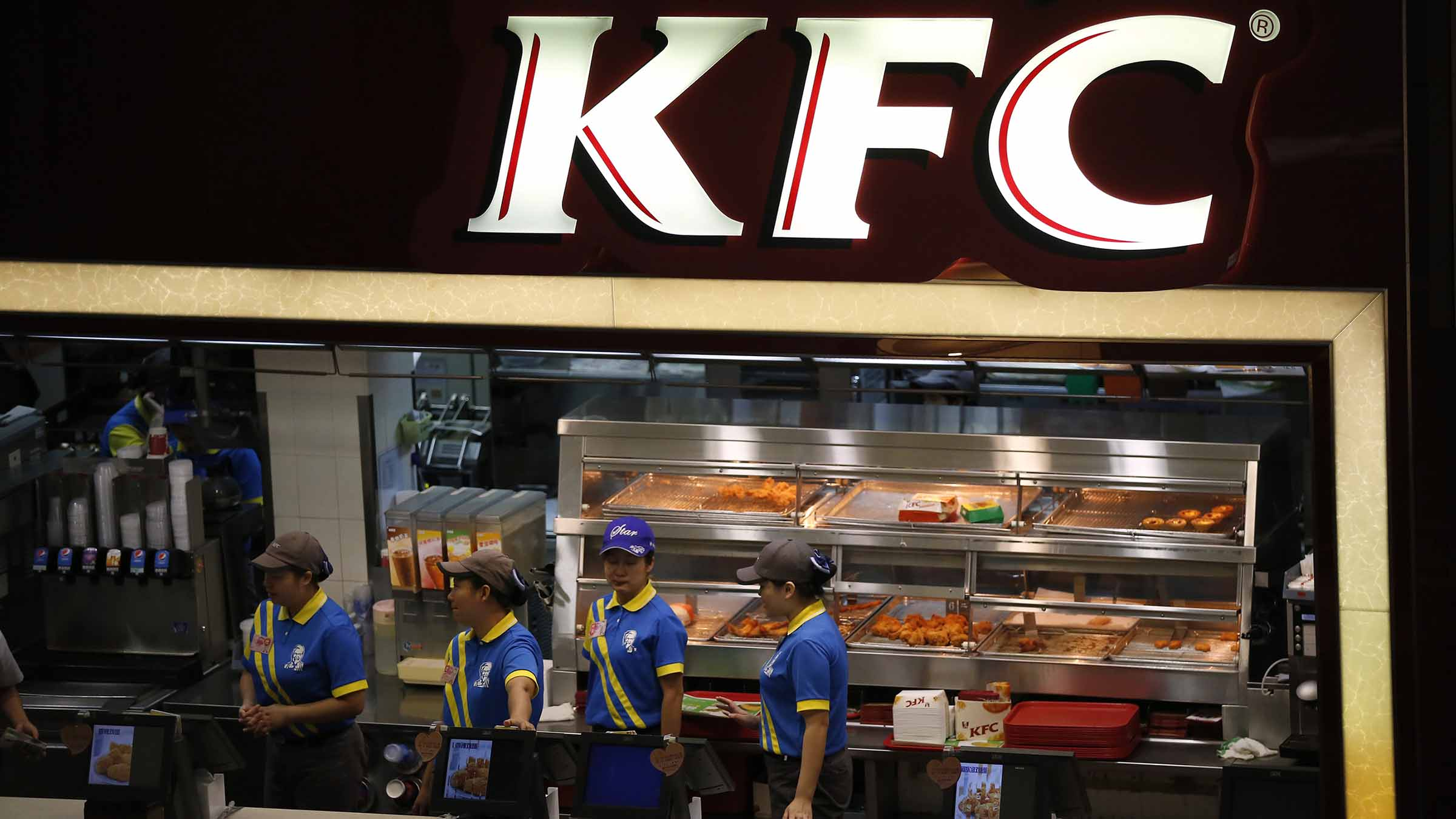 Employees work at a KFC store in Shanghai