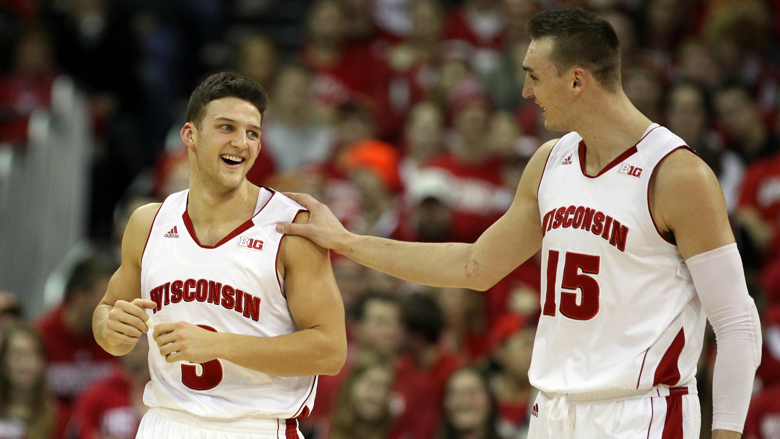 Wisconsin Badgers guard Zak Showalter (3) gets a pat on the shoulder from Wisconsin Badgers forward Sam Dekker (15) at the Kohl Center.