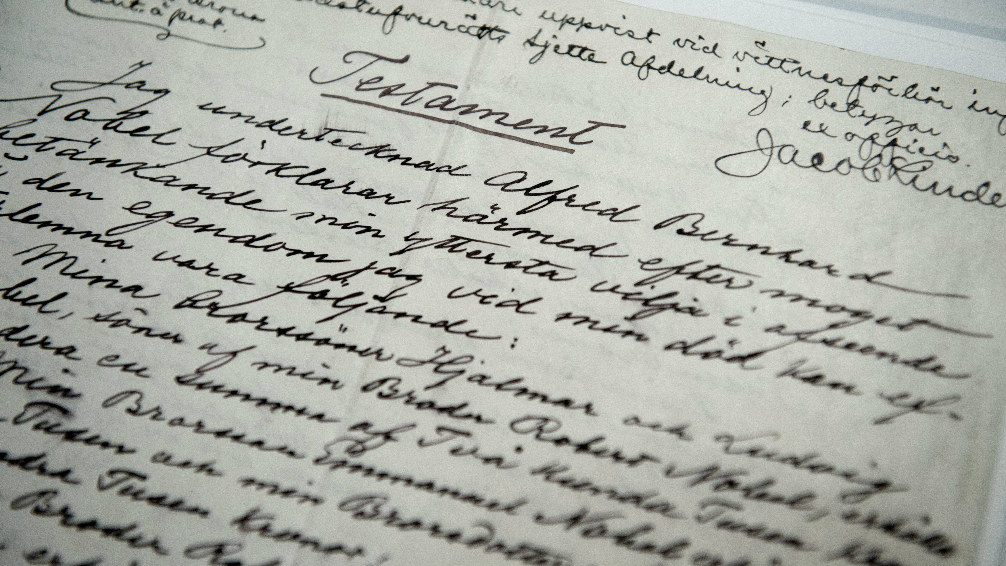 The testament of Alfred Nobel is shown by a senior curator at the Nobel Museum.