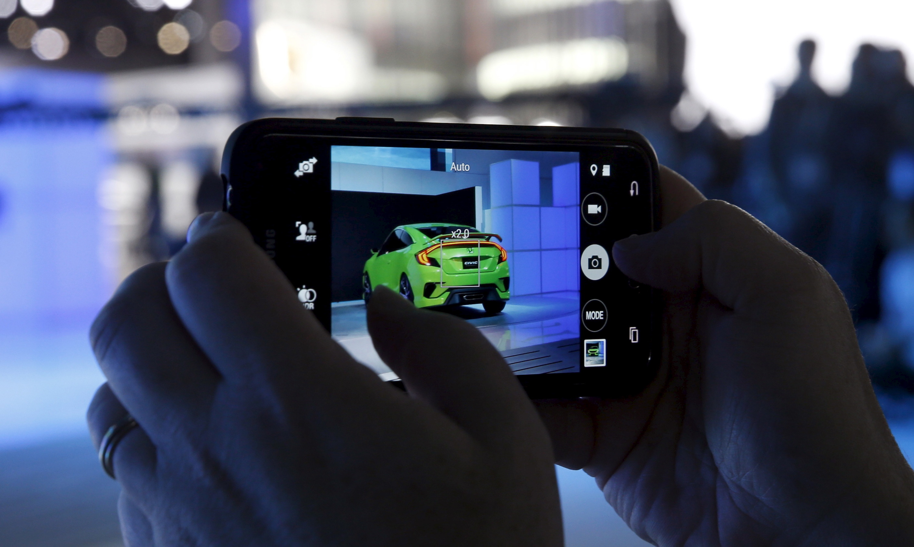 A man records with his mobile phone as Honda unveils a Civic concept car at the New York International Auto Show in New York April 1, 2015. REUTERS/Shannon Stapleton - RTR4VSLF