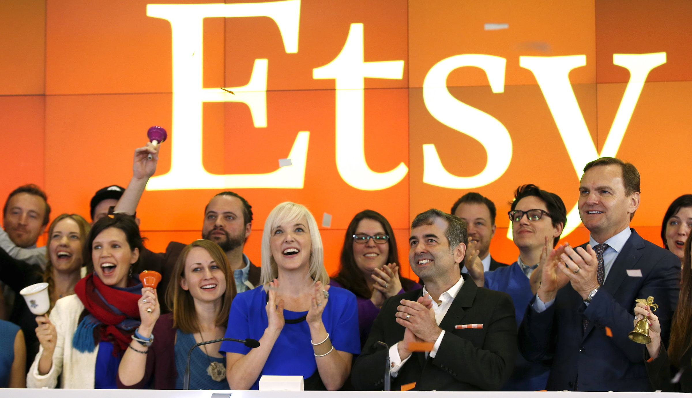 Etsy Inc's Chief Executive Officer Chad Dickerson (2nd from R) and Chief Financial Officer Kristina Salen (C) stand with Etsy Employees and Nasdaq Executive Vice President Bruce Aust (R) as they celebrate Etsy's initial public offering (IPO) at the Nasdaq market site in New York April 16, 2015. Etsy's initial public offering has been priced at $16 per share, a market source told Reuters, valuing the online seller of handmade goods and craft supplies at about $1.78 billion.  REUTERS/Mike Segar - RTR4XLTC