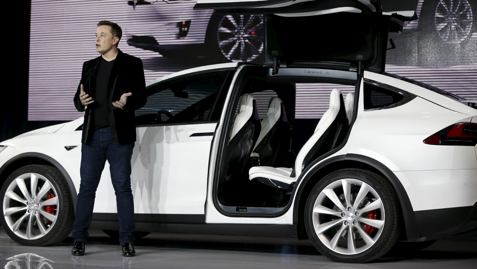 Tesla could finally set up shop in indiabut not with its cars quartz tesla motors ceo elon musk introduces the falcon wing door on the model x electric sports malvernweather Gallery