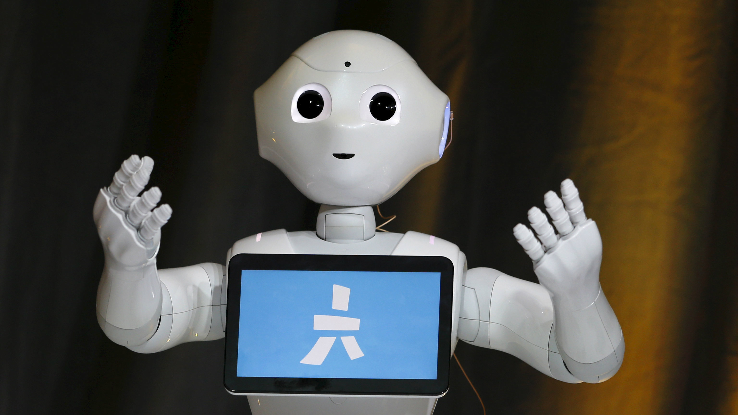 Pepper, an emotional Robot, greets conference attendees during the Wall Street Journal Digital Live.