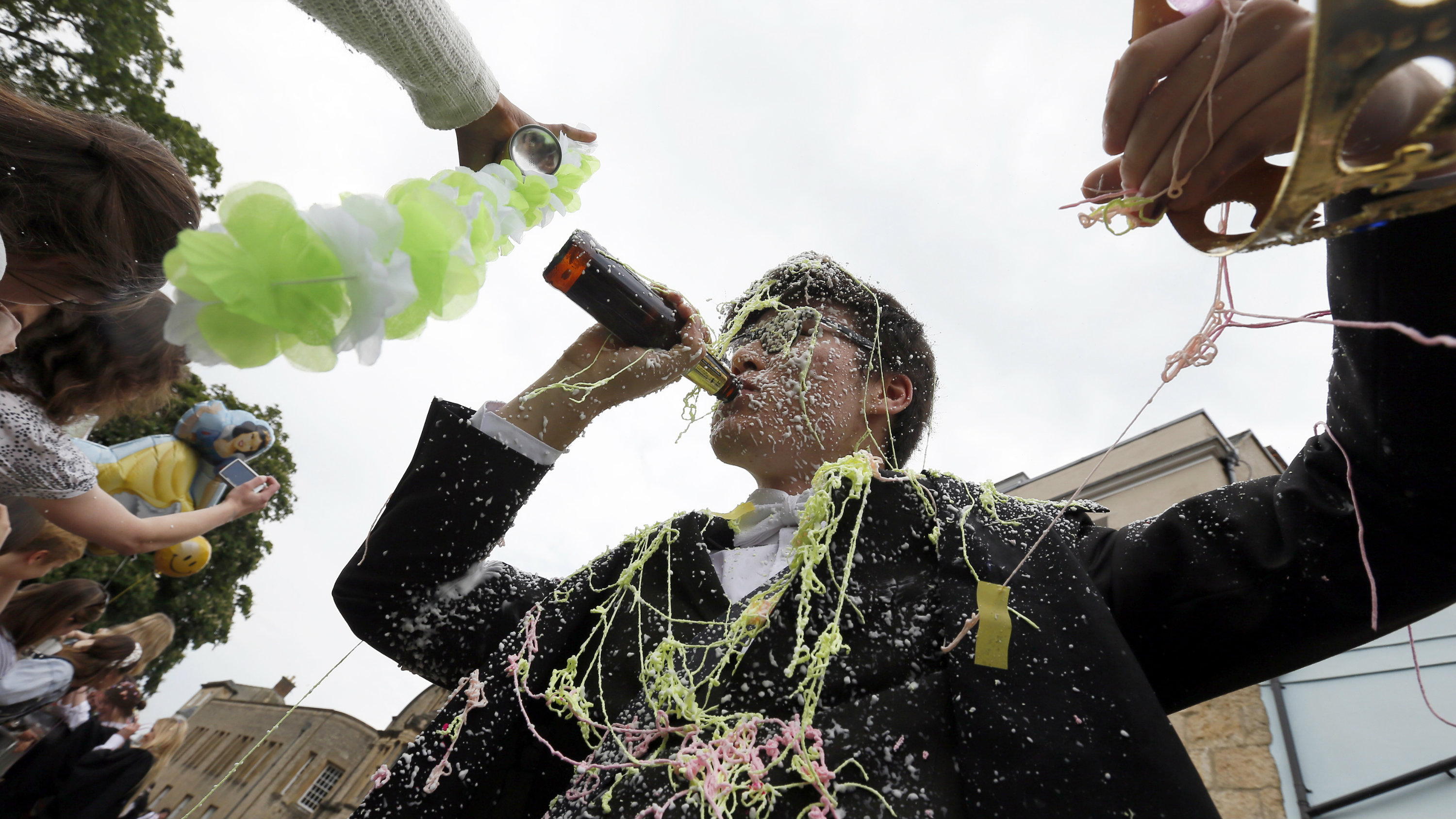 "A student from University College Oxford gets ""trashed"" after finishing his exams in Oxford, southern England June 7, 2013"