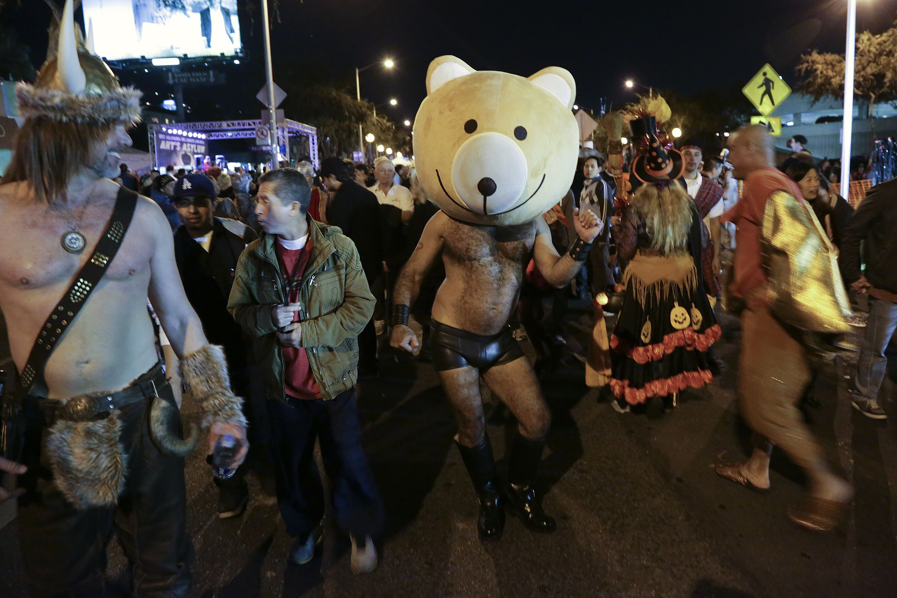 Revelers dance on the street during the West Hollywood Halloween Costume Carnaval, which attracts nearly 500,000 people annually in West Hollywood, California October 31, 2013. REUTERS/Jonathan Alcorn (UNITED STATES - Tags: SOCIETY) - RTX14W4B