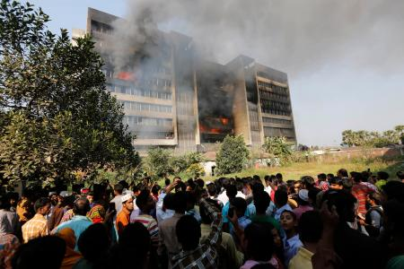 Garment workers gather in front of the Standard Group garment factory which was on fire in Gazipur November 29, 2013.