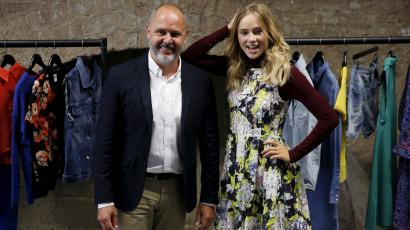 Vice President of Amazon Fashion EU Sergio Butcher (L) and Amazon Fashion European Brand Ambassador Suki Waterhouse pose for photographers at the launch of the Amazon Fashion Photography Studio in east London, Britain July 23, 2015. Amazon's new 46,000 square foot fashion photography studio will produce more than half a million images over the next 12 months to support its rapidly growing fashion business.