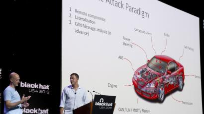 Charlie Miller (L) and Chris Valasek give a briefing during the Black Hat USA 2015 cybersecurity conference in Las Vegas, Nevada August 5, 2015. Miller and Valasek talked about how they remotely hacked into a 2014 Jeep Cherokee.
