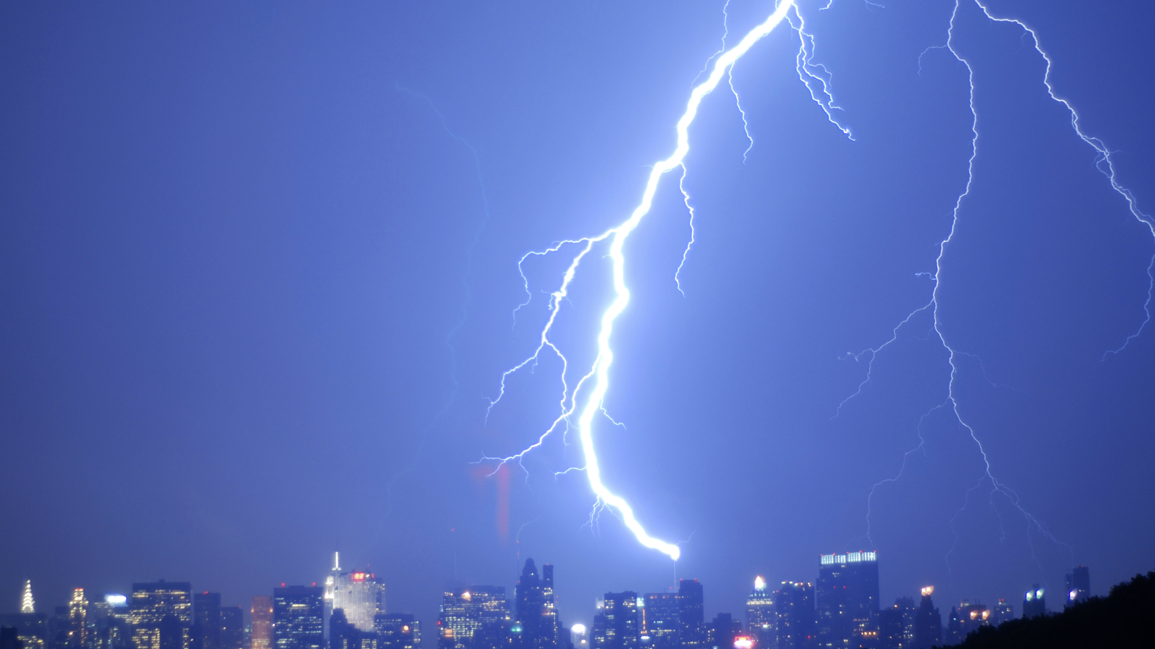 The New York Times building is struck by lightning in New York.