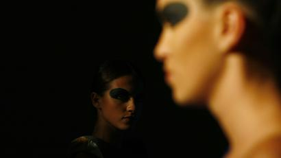 Models present creations by designer Demna Gvasalia during Athens Fashion Week, October 10, 2008.