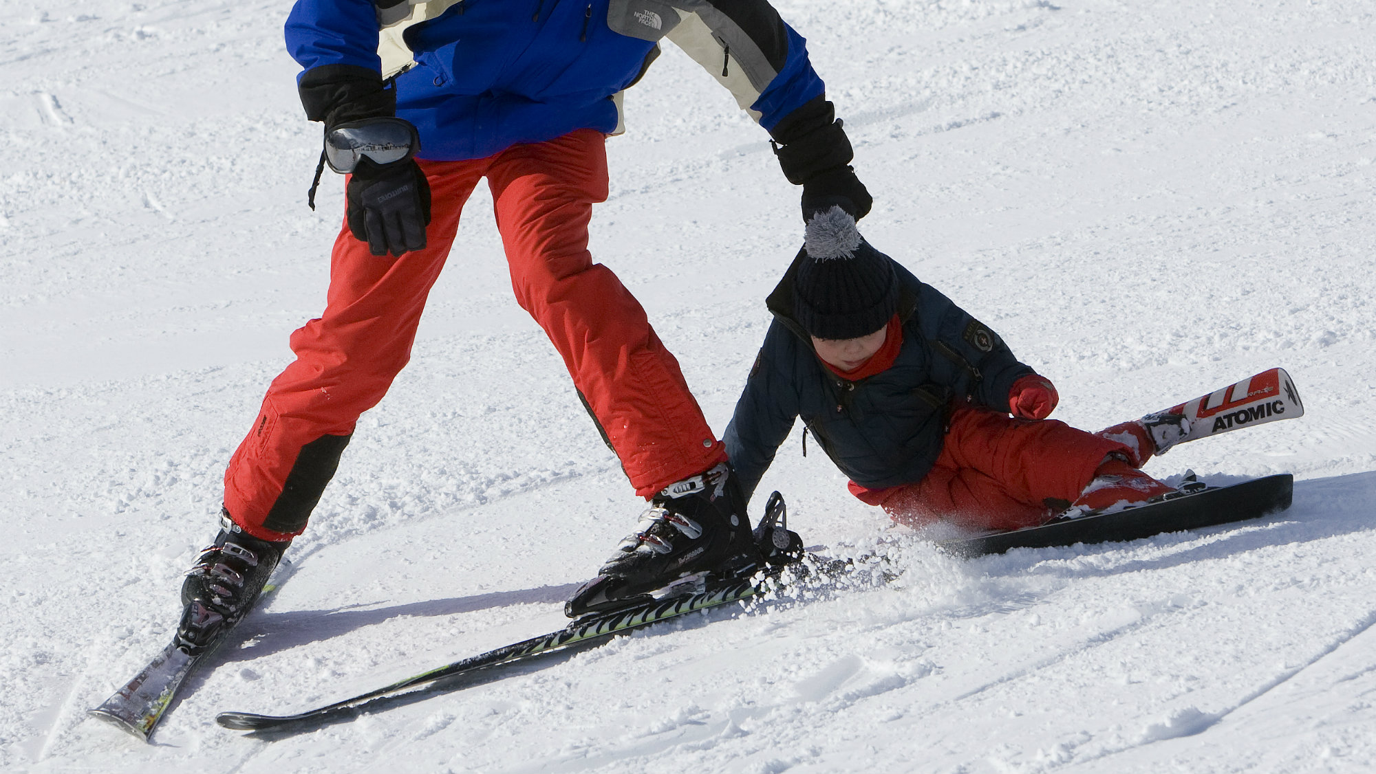 Prince Constantijn holds his son Claus-Casimir as he crashes during a photocall in the Austrian alpine...