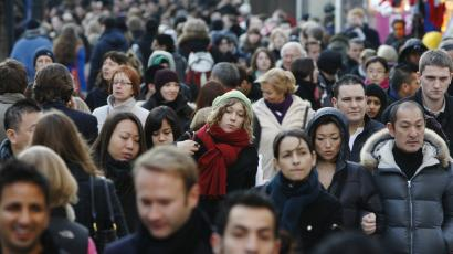 Crowds of shoppers pack Oxford Street on the last shopping weekend before Christmas in London.