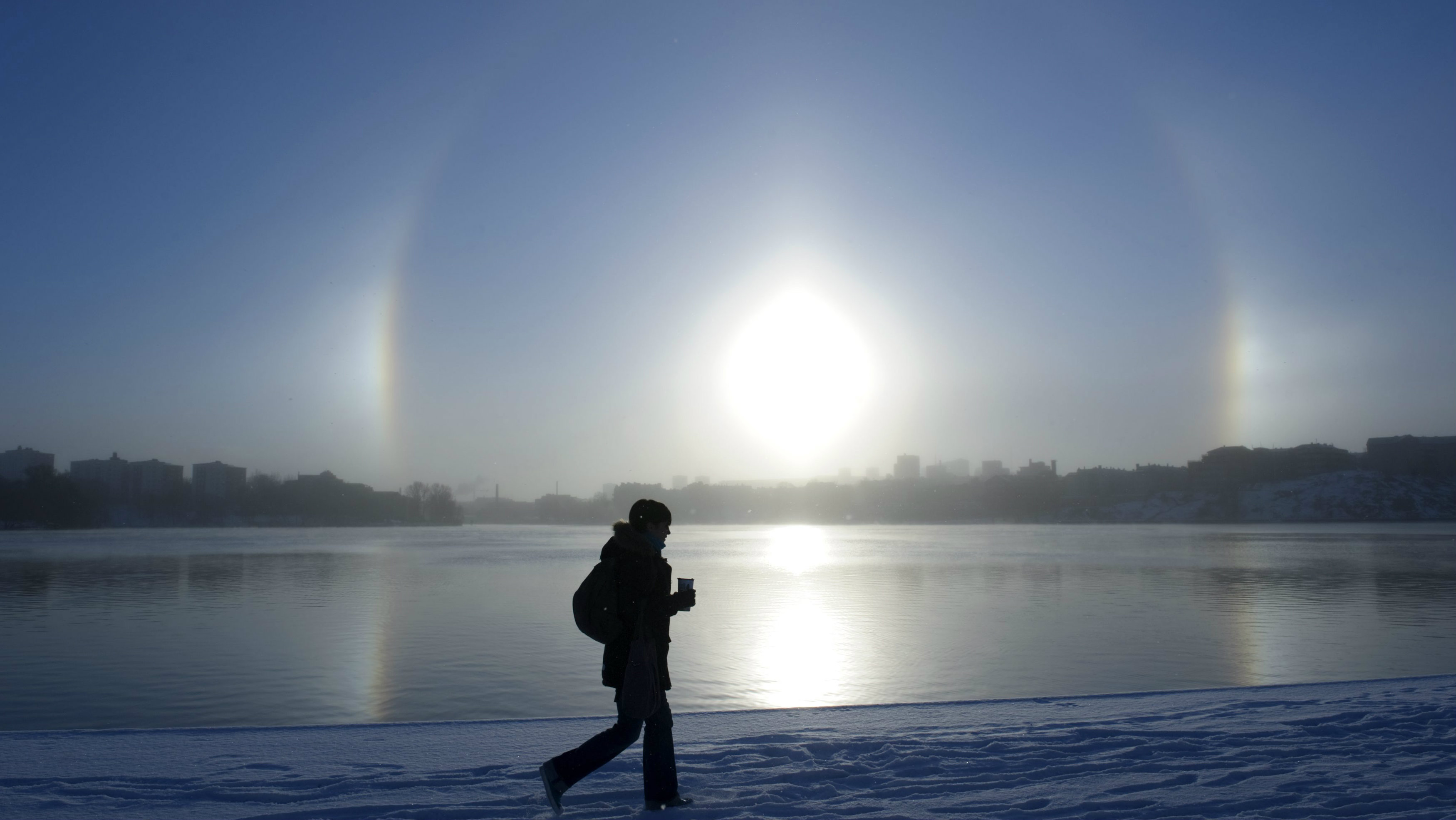 A parhelion (sundog) combined with a halo is seen over Lake Malaren in central Stockholm.
