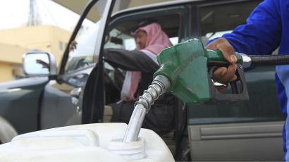 An employee fills a container with diesel at a gas station in Riyadh December 19, 2012.