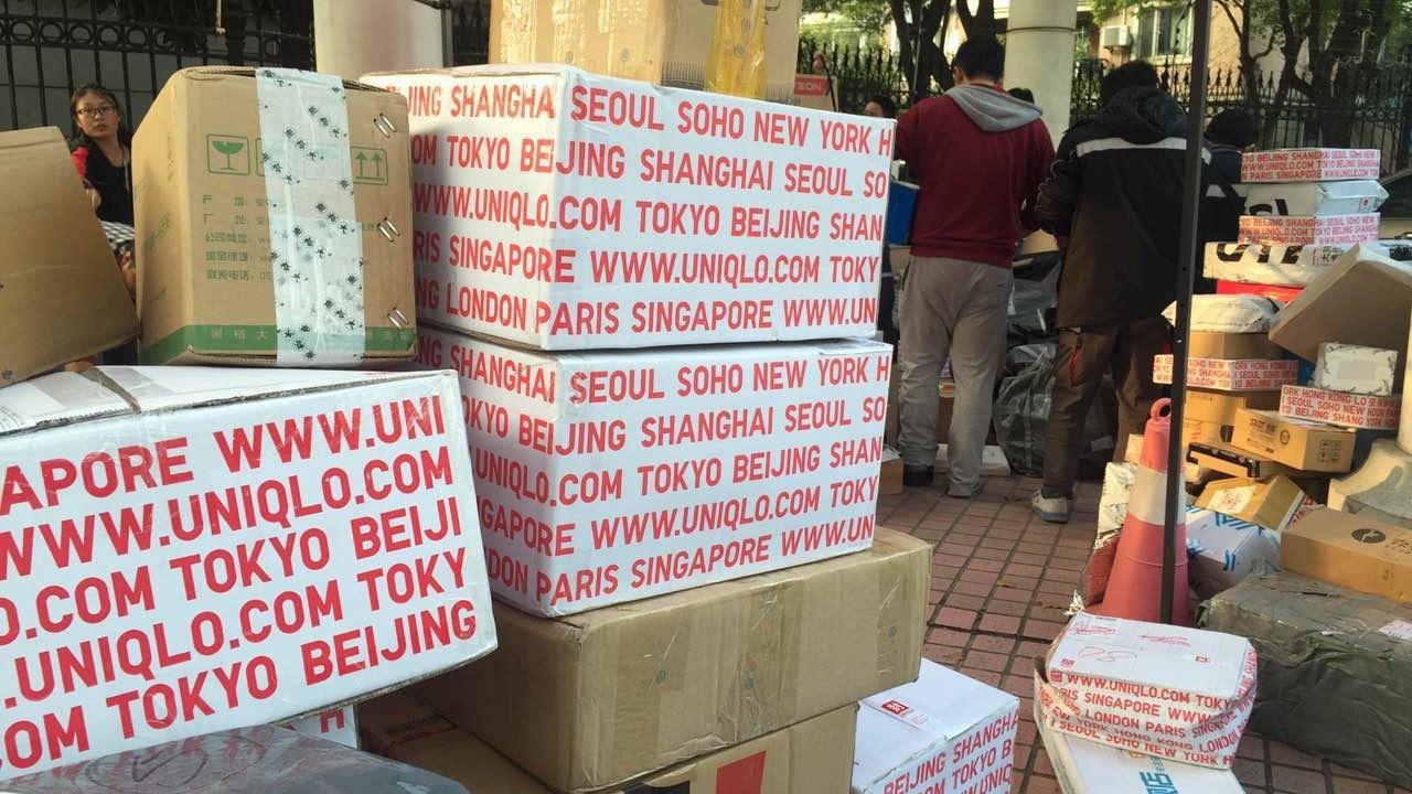shangai boxes on street single day e-commerce china