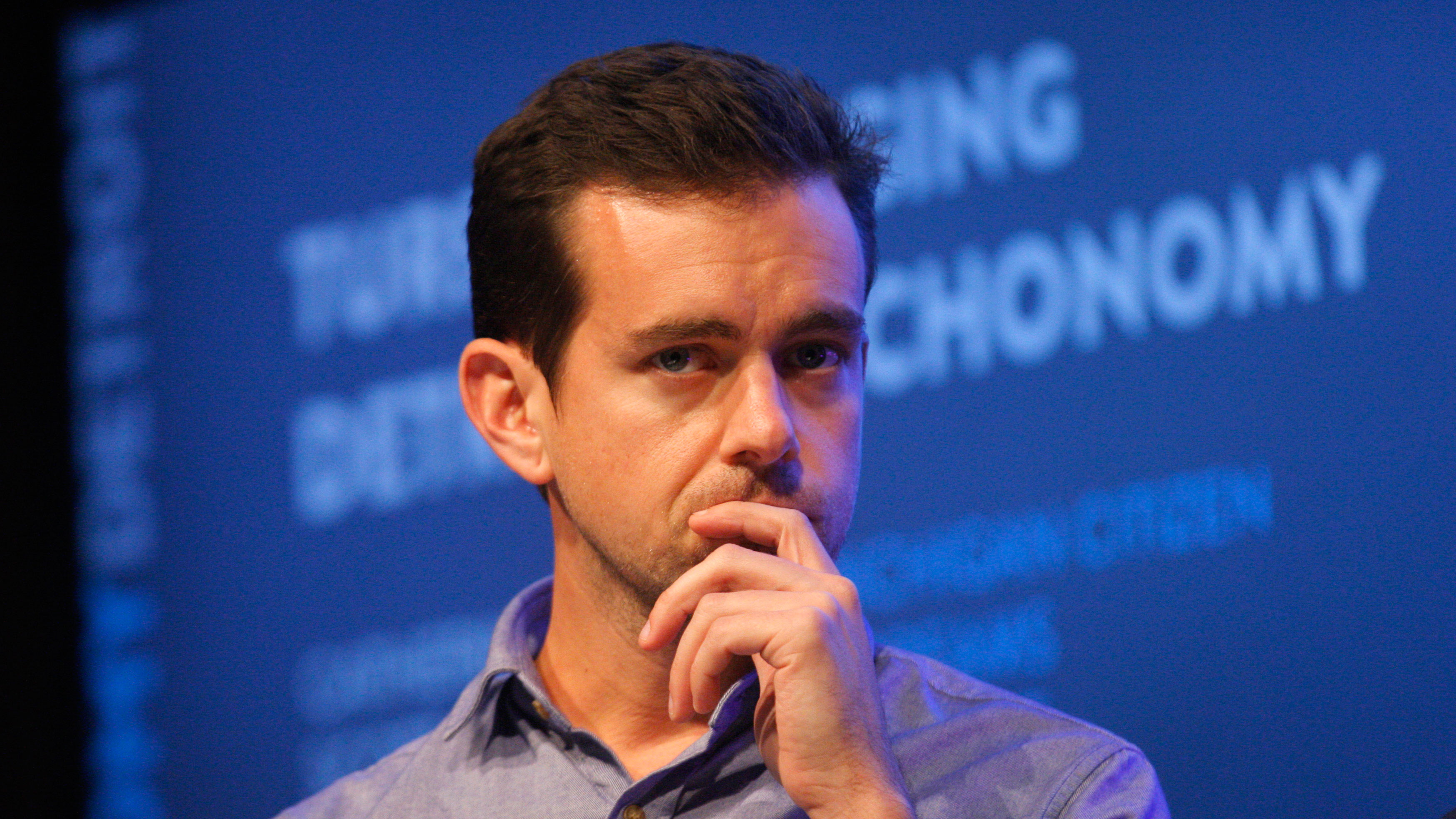 Jack Dorsey, chairman of Twitter and CEO of Square, listens to a fellow panelist during a Techonomy Detroit panel discussion held at Wayne State University in Detroit, Michigan September 17, 2013. REUTERS/Rebecca Cook (UNITED STATES - Tags: BUSINESS SCIENCE TECHNOLOGY)