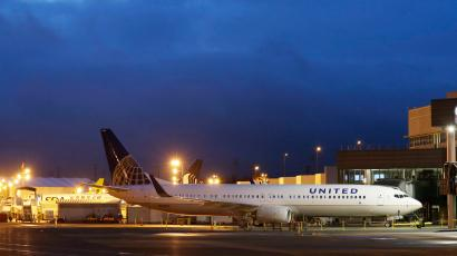 A new Boeing 737-900ER airplane being delivered to United Airlines is parked in front of Boeing's newly expanded 737 delivery center, Monday, Oct. 19, 2015, at Boeing Field in Seattle. The center will be the main delivery point for various configurations of the 737 single-aisle airplanes to customers and is double the size of the previous building. (AP Photo/Ted S. Warren)