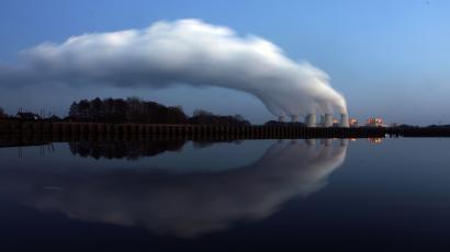 Steam billowing from the cooling towers of Vattenfall's Jaenschwalde brown coal power station.