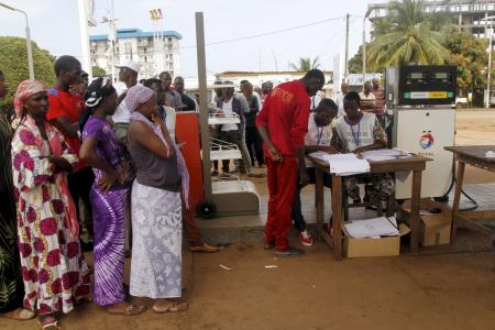 A petrol station in Conakry is turned into a polling station.