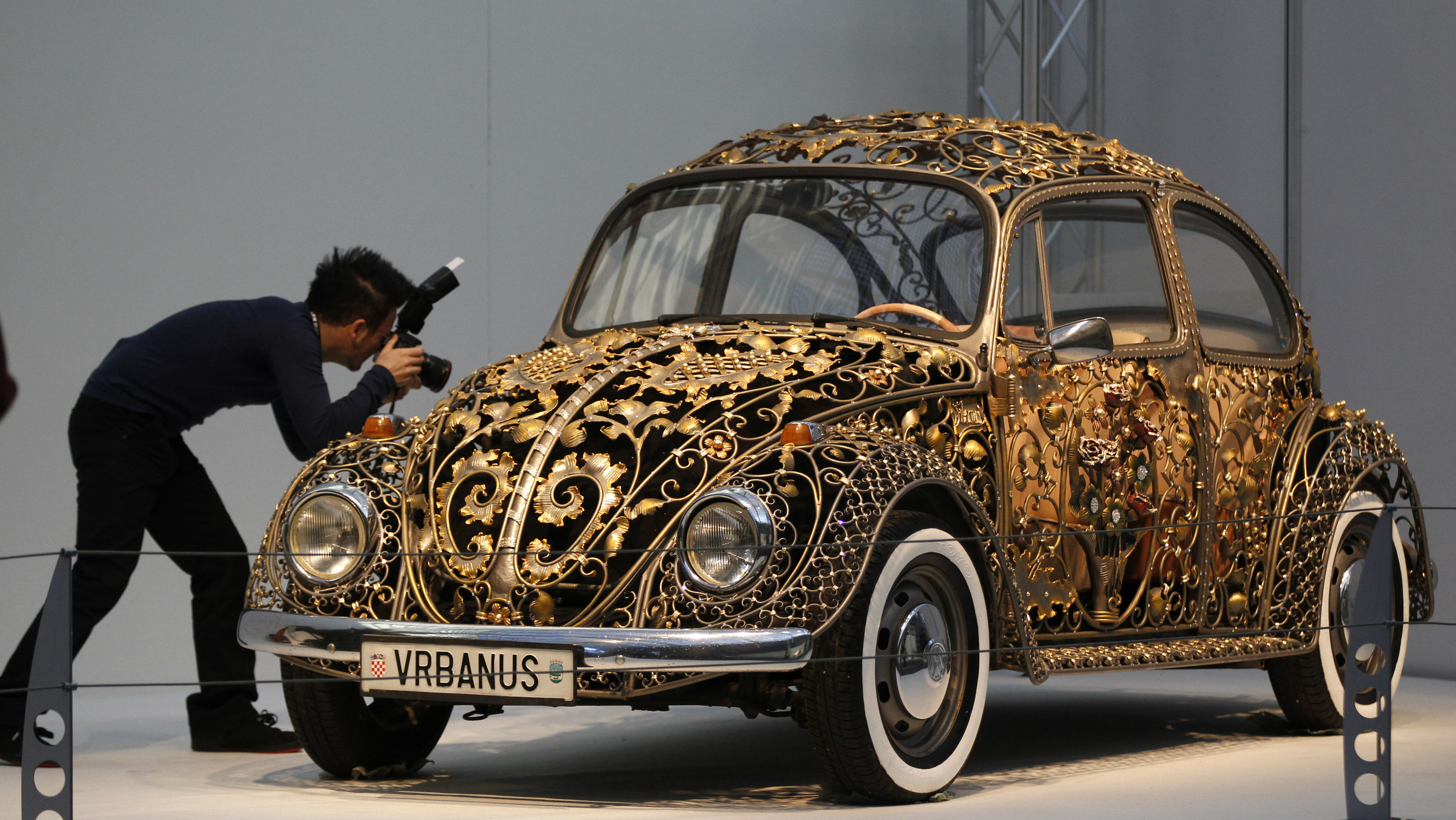 A visitor takes a picture at a modified Volkswagen VW Beetle during a press presentation prior to the Essen Motor Show in Essen November 30, 2012.