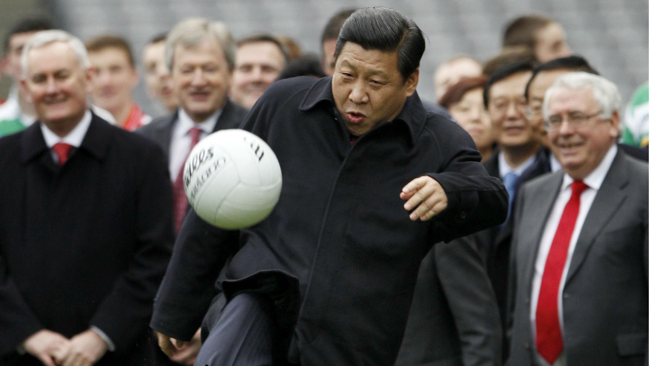 China's Vice-President Xi Jinping kicks a football during a visit to Croke Park in Dublin, Ireland February 19, 2012. REUTERS/David Moir