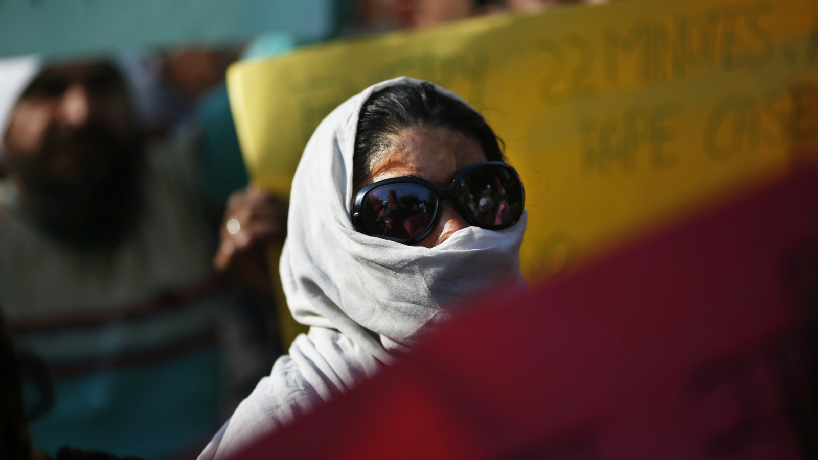 An unidentified woman who had acid thrown upon her face, participates in a protest against the inefficiency of government in punishing rapists as the conviction rate in the entire country remains extremely low in New Delhi, India, Friday, Dec. 21, 2012. The hours-long gang-rape and near-fatal beating of a 23-year-old student by six men on a bus in New Delhi recently has triggered outrage and anger across the country as Indians demanded action from authorities who have long ignored persistent violence and harassment against women. (AP Photo/ Saurabh Das)