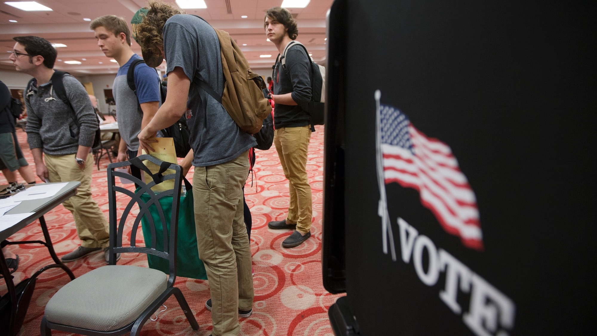 A voter places his ballot in a bag to be counted at a polling station at The Ohio State University student union, Tuesday, Nov. 3, 2015, in Columbus, Ohio. Ohio voters headed to the polls today to decide whether to allow marijuana to be grown, processed and consumed within the state's borders. (AP Photo/John Minchillo)