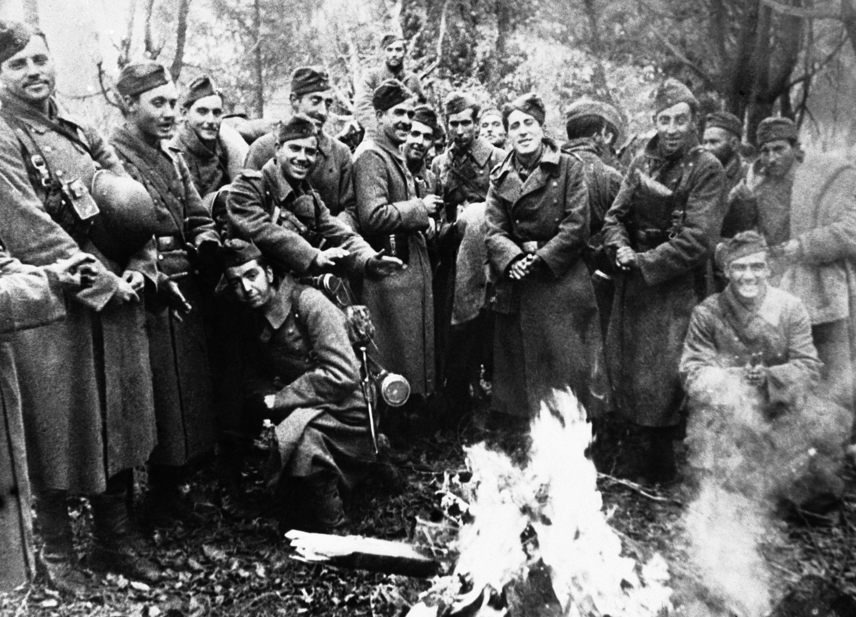 Members of one of the volunteer Spanish Blue Divisions, serving with the Nazis, grouped round a fire on the Moscow front on Dec. 15, 1941. It was stated that the divisions from Spain are feeling the cold tremendously in Russia and are now literally blue with cold. (AP Photo)