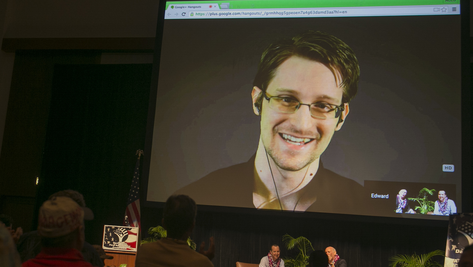 National Security Agency leaker Edward Snowden appears on a live video feed broadcast from Moscow at an event sponsored by the ACLU Hawaii in Honolulu on Saturday, Feb. 14, 2015.