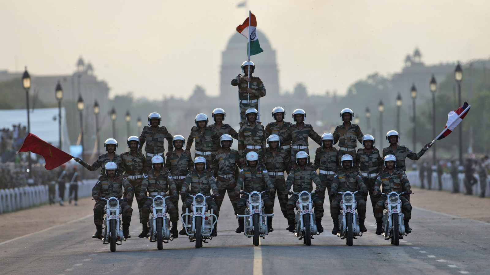 Indian army soldiers perform a daredevil motorcycle stunt during a parade to mark the 50th anniversary of the India-Pakistan war of 1965, in New Delhi, India, Sunday, Sept. 20, 2015. The parade concluded celebrations to honor soldiers who fought the war in 1965.