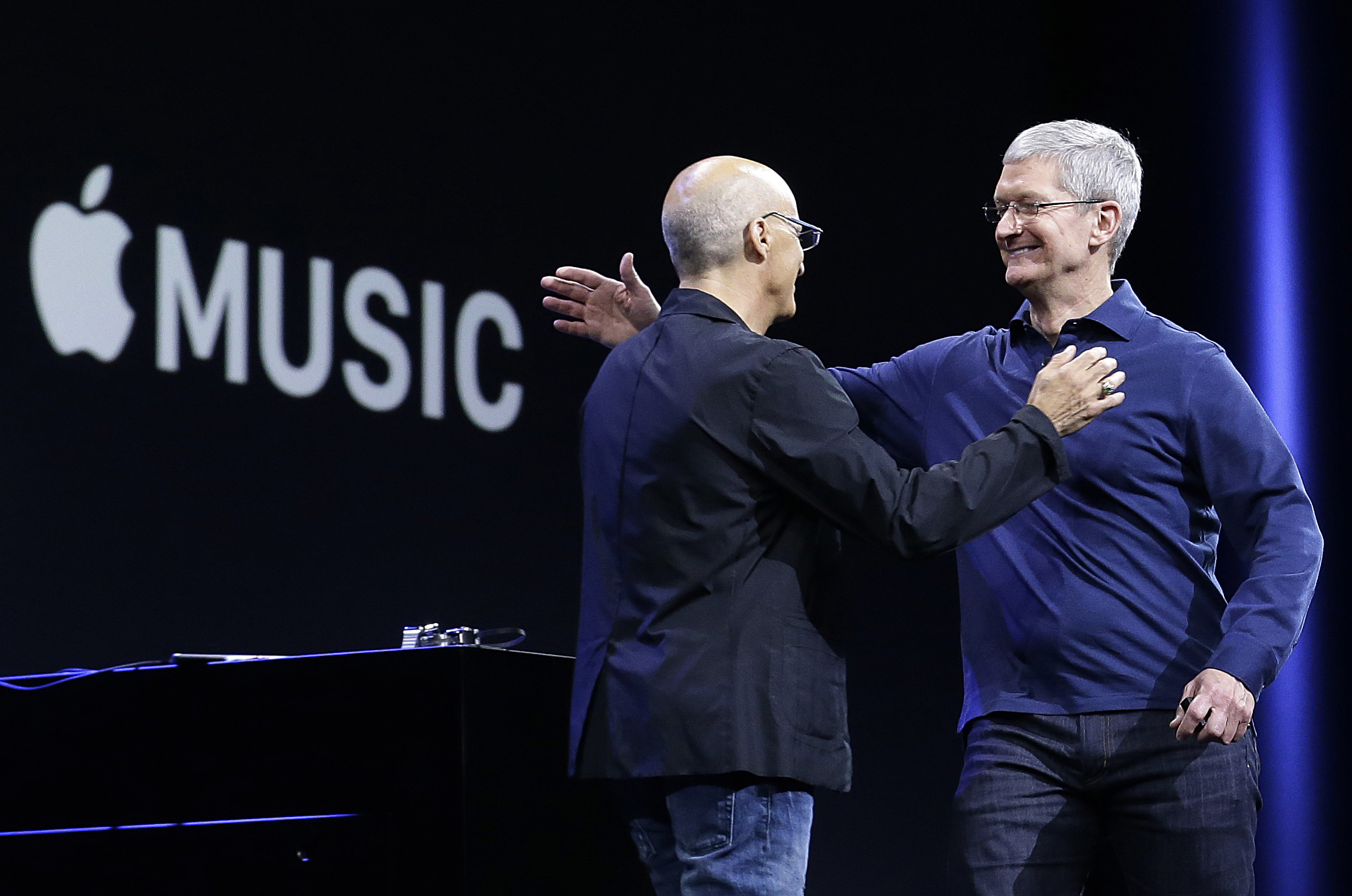 "FILE - In this June 8, 2015 file photo, Apple CEO Tim Cook, right, hugs Beats by Dre co-founder and Apple employee Jimmy Iovine at the Apple Worldwide Developers Conference in San Francisco when Apple announced Apple Music, an app that combines a 24-hour, seven-day live radio station called ""Beats 1"" with an on-demand music streaming service. Apple Inc. says it has 15 million users on its streaming-music service, including 6.5 million paying subscribers. The Wall Street Journal says (http://on.wsj.com/1LAy1Mz ) in a report from Laguna Beach, California, posted early Tuesday, Oct. 20 on its website that Apple launched Apple Music on June 30 and offered every user a three-month trial period. (AP Photo/Jeff Chiu, File)"