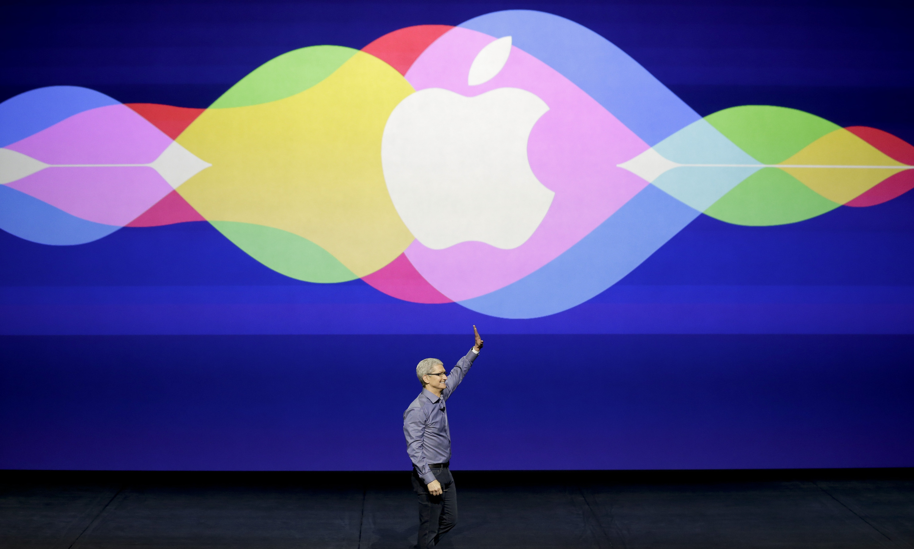 Apple CEO Tim Cook waves during the Apple event at the Bill Graham Civic Auditorium in San Francisco, Wednesday, Sept. 9, 2015. (AP Photo/Eric Risberg)