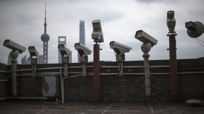Security cameras are seen on a building at the Bund in front of the financial district of Pudong in Shanghai March 6, 2015