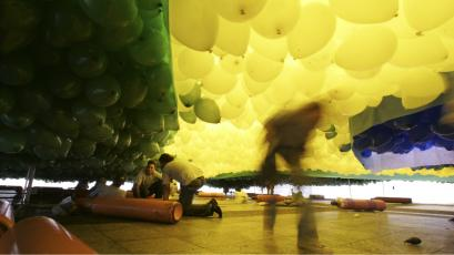Men arrange balloons, in the colors of Brazil's national flag, before releasing them into the air during a year-end ceremony in downtown Sao Paulo.