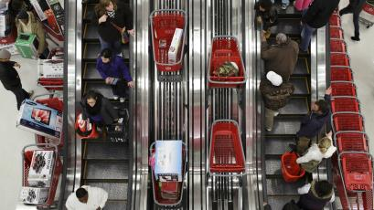 Shoppers ride an escalator at a Target Store in Chicago, Illinois.