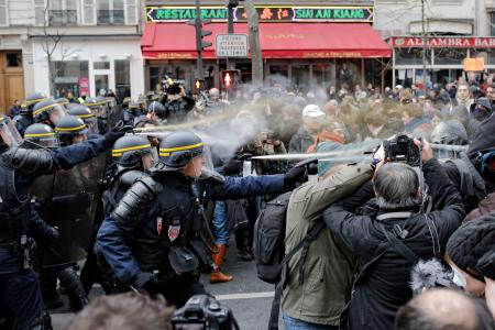 Policemen fight with activists during a protest ahead of the 2015 Paris Climate Conference