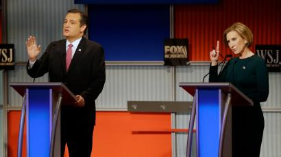 Ted Cruz speaks as Carly Fiorina tries to make a comment during Republican presidential debate at Milwaukee Theatre, Tuesday, Nov. 10, 2015, in Milwaukee.