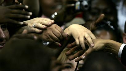 Supporters reach out to touch the hand of democratic presidential candidate Barack Obama in 2008.