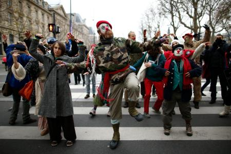 Environmentalists dance during a protest near the Place de la Republique.