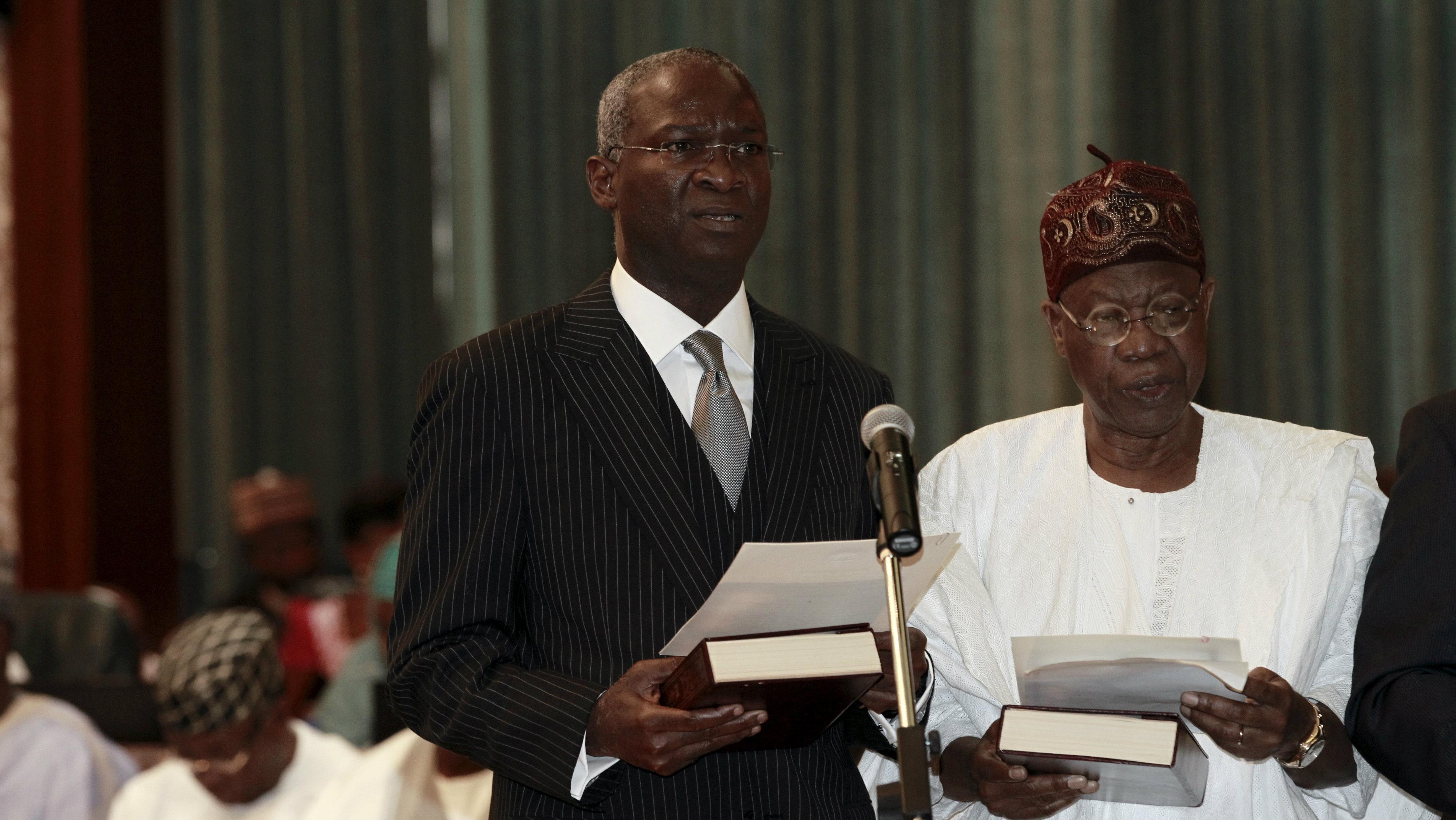 Nigeria's president Buhari has sworn in a new cabinet at