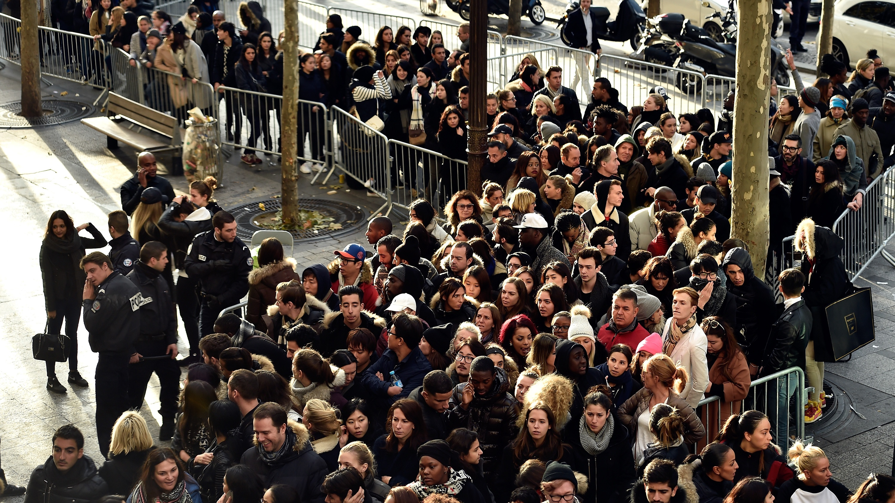 People wait to enter H&M before the Balmain X H&M Collection Launch at H&M Champs Elysees on November 5, 2015 in Paris, France.